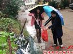 常宁市水利局进社区开展卫生清扫活动